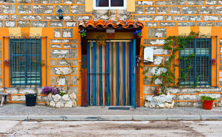 Detail of the Facade of Spanish Homes Decorated with Flowers Stock Photo - 9266374