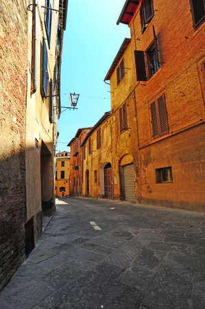 Narrow Alley With Old Buildings In Italian City of Siena photo