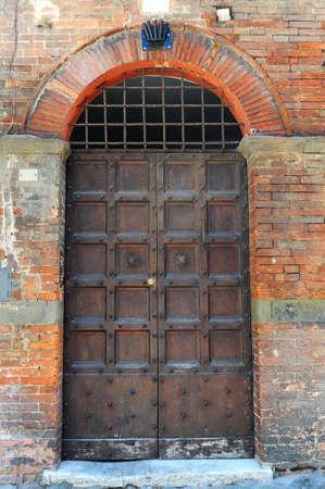 old doors: Close-up Image Of Wooden Ancient Italian Door Stock Photo