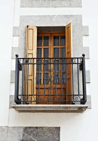 castings: The Renovated Facade of the Old Spanish House with Balcony Stock Photo