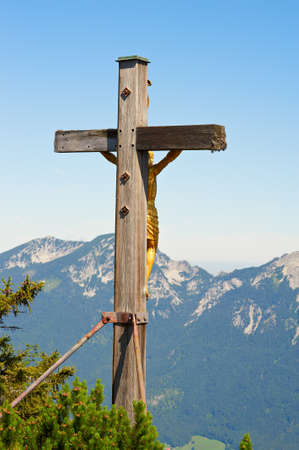 Gold crucifix on top of a mountain Predigtstuhl, Germany photo