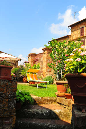 Deck Chair Standing In The Courtyard Of an Italian Home photo