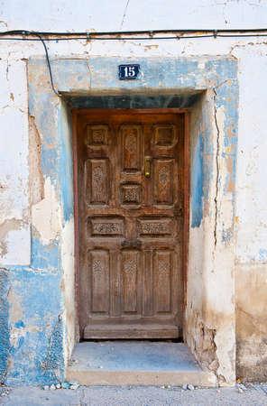 Broken Wooden Door in the Poor Spanish House  photo