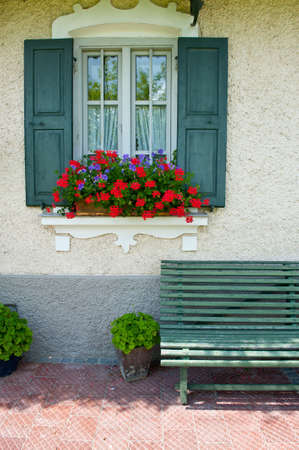 Typical Bavarian Window With Open Wooden Shutters, Decorated With Fresh Flowers photo