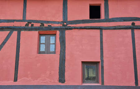 Pink Wall Spanish House with Wooden Beams and  Windows Stock Photo - 11354846