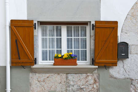 Decorated Closed Window and Postbox in Spanish Town photo