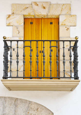 The Renovated Facade of the Old Spanish House with Balcony Stock Photo - 11671772