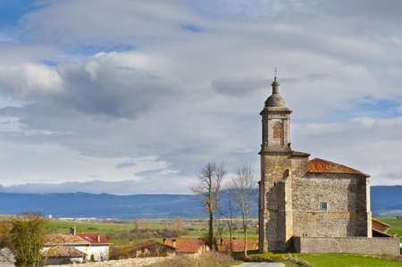 Medieval Spanish Church Surrounded by Fields in the Rainy Weather photo