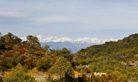 Winding Mountain Road on the Background of Snow-capped Pyrenees photo