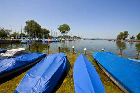 Tarpaulin Covers for Boats, the Lake Chiemsee in Bavaria Standard-Bild