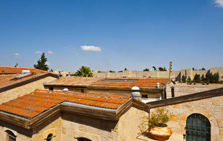 The Roofs of Jerusalem against the Walls of the Old City Stock Photo - 11671798