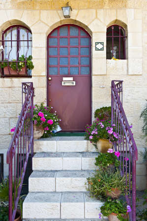 Detail of the Facade of Israel Home Decorated with Flowers photo