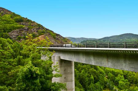 Concrete Bridge Across the Ravine in the French Alps photo
