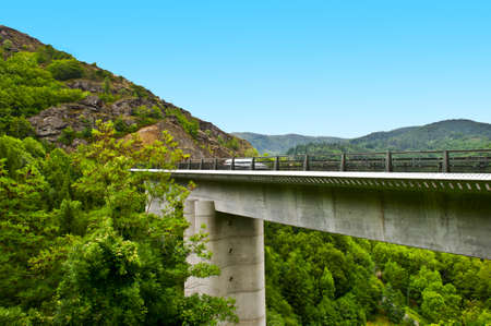 ravine: Concrete Bridge Across the Ravine in the French Alps Stock Photo