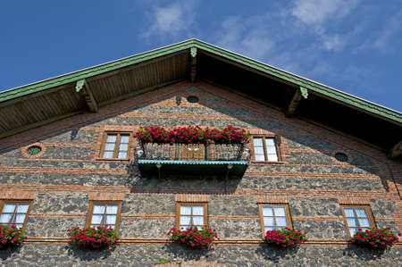 Facade Decorated With Fresh Flowers in the Bavarian Alps, Germany photo