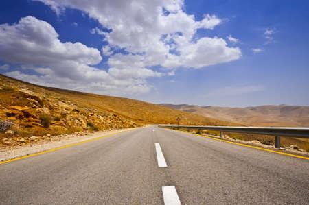 rocky road: Meandering Road In Sand Hills of Samaria, Israel