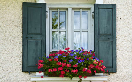 Bavarian Window With Open Wooden Shutters, Decorated With Fresh Flowers Stock Photo - 12396136
