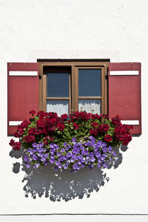 Typical Bavarian Window With Open Wooden Shutters, Decorated With Fresh Flowers Stock Photo - 12396132