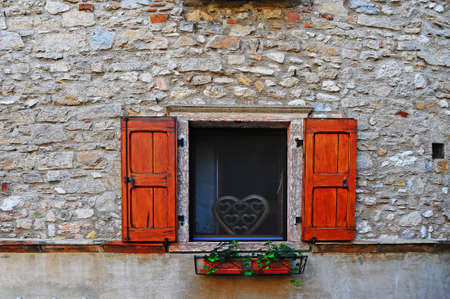 Italian Window With Open Wooden Shutters, Decorated With Fresh Flowers Stock Photo - 12396146