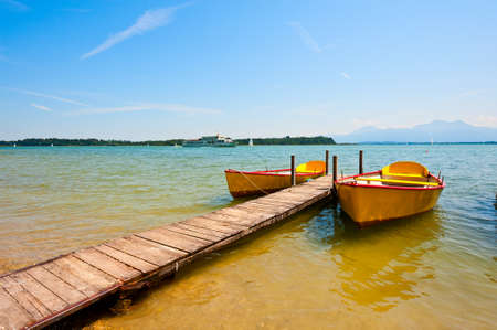 yellow boats: Yellow Boats Moored on the Lake  Chiemsee Stock Photo
