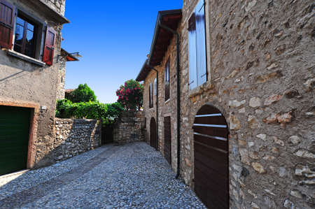 Narrow Alley With Old Buildings In The Chianti Region photo