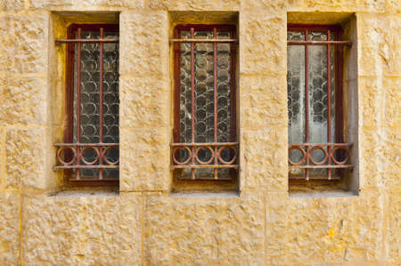 Decorated Closed Windows Of Old Building In Jerusalem, Israel photo