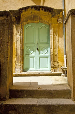 Wooden Door to the Patio in the French City photo