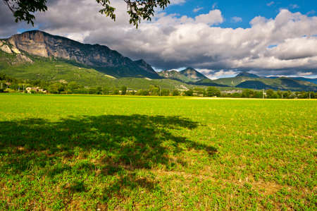 Farmhouse Surrounded by Fields in the French Alps photo