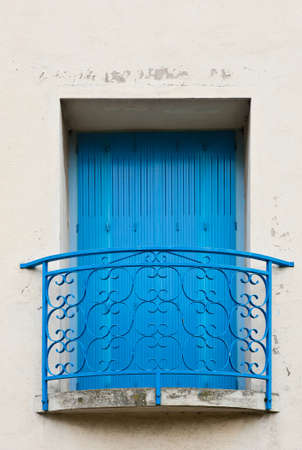 French Window with the Blue Balcony and Shutter  Stock Photo - 12396316