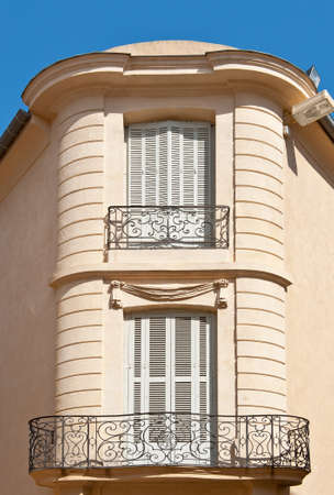 Two  French Windows on the Facade of old House  photo
