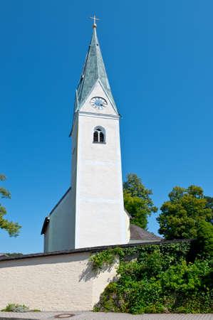 renewed: Christian Church with Clock Tower in Southern Bavaria Stock Photo