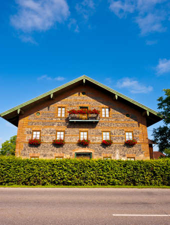 Facade Decorated With Fresh Flowers in the Bavarian Alps, Germany Stock Photo - 12768690