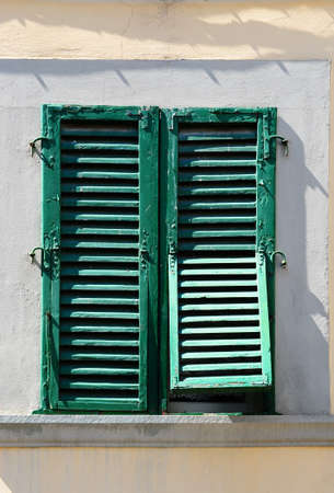 Italian Window with Closed Wooden Shutters photo