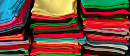 Colorful T-shirts on the Counter for Sale