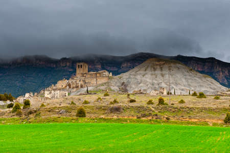 The Ruins of Medieval Spanish Town in Rainy Day photo