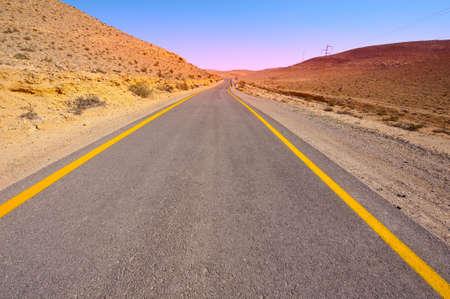 Asphalt Road in Sand Hills of Negev Desert, Israel photo