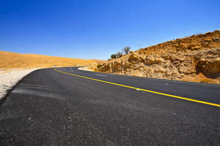Asphalt Road in Sand Hills of Samaria, Israel photo