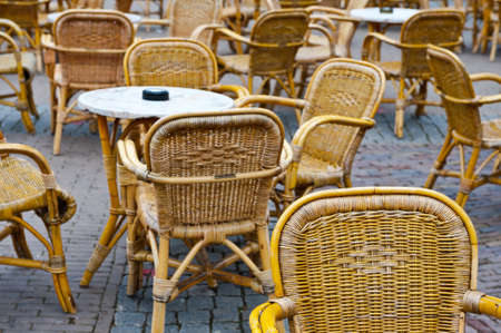Wicker Chairs and Tables in a Street Cafe Stock Photo - 13949314