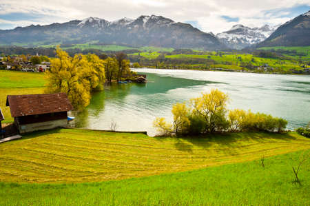 harbors: Lake Sarner on the Background of Snow-capped Alps, Switzerland Stock Photo