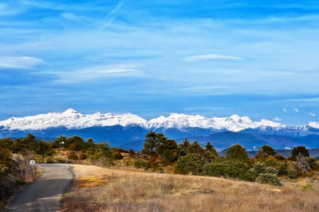 snowcapped: Winding Mountain Road on the Background of Snow-capped Pyrenees