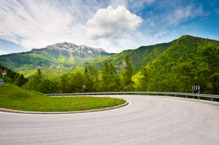 empty street: Winding Paved Road in the Italian Alps