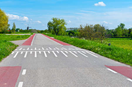 Road Markings for Bicyclists on the Road in Holland Stock Photo