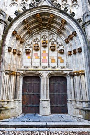 Detail of  Portal of the Gothic Church St Hubert in Belgium photo