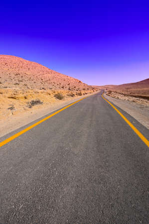 Asphalt Road above Grand Crater in Negev Desert, Israel, Sunset photo