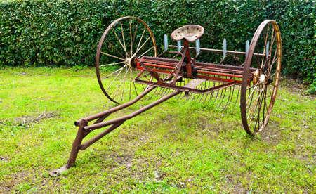 winnowing: Old Winnowing Machine on the Green Grass Stock Photo