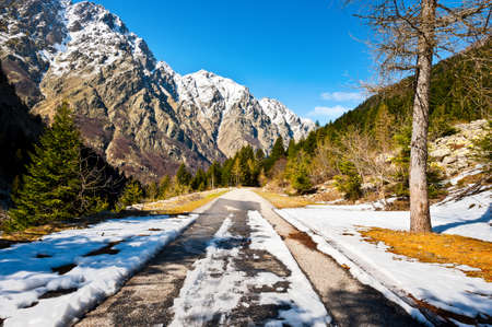 Melting Snow on the Mountainous Road in the Italian Alps