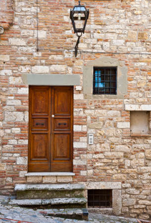 Wooden Ancient Italian Door in Historic Center photo