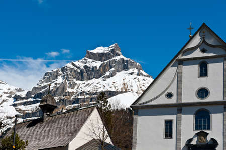 snowcapped: Church on the Background of Snow-capped Alps, Switzerland