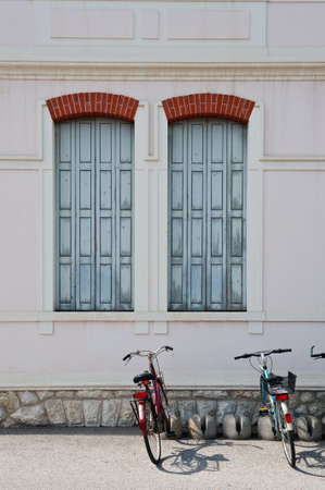 Italian Windows with Closed Wooden Shutters photo