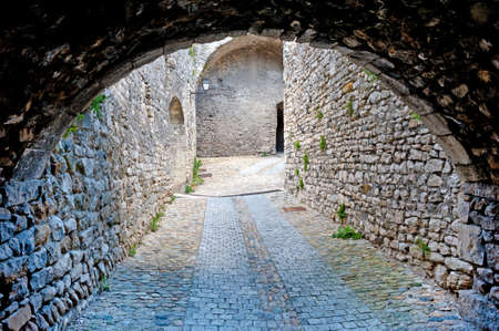 Narrow Dark Streets in the French Medieval City photo